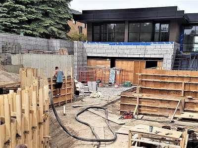 Man Constructing a House