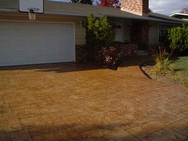 Brown Driveway with White Garage Door