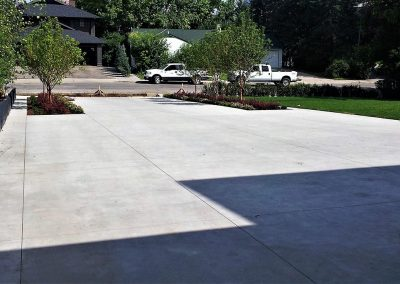 Concrete Driveway and Two Trucks