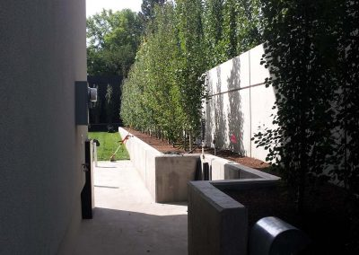 Narrow concrete hall way