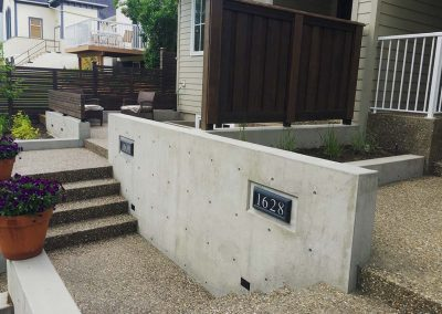 Small Concrete Walls with Address Numbers