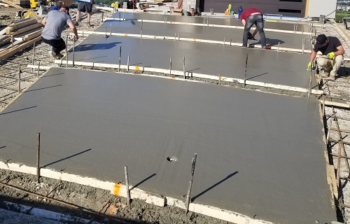 Contractors Pouring Concrete
