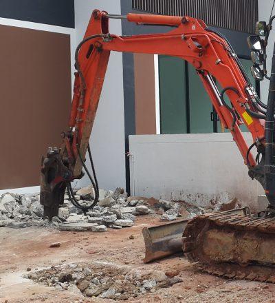 Bulldozer breaking concrete