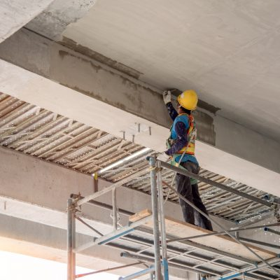 Construction worker plastering cement concrete