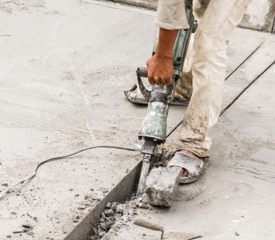 Construction worker using jackhammer